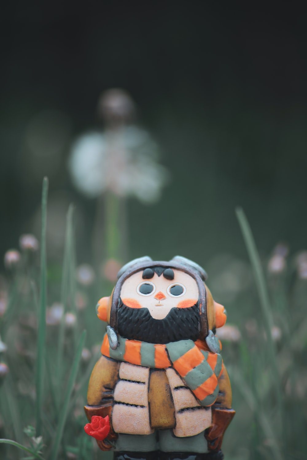 orange and black lego toy on green grass