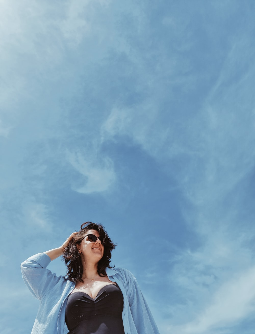 woman in white shirt under blue sky during daytime