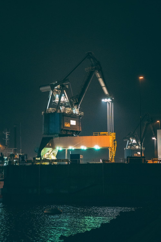 blue and orange crane during night time