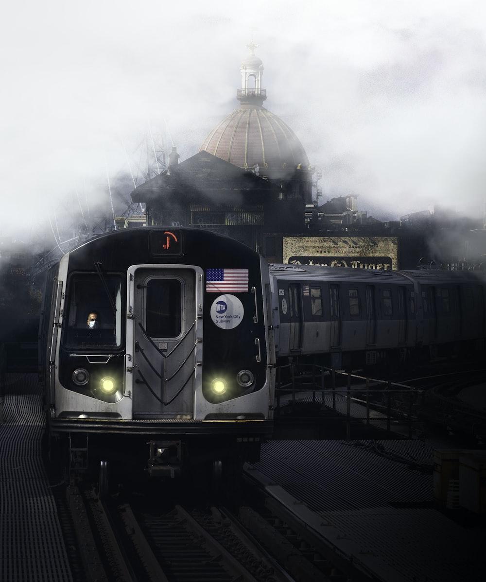 green and black train on rail tracks