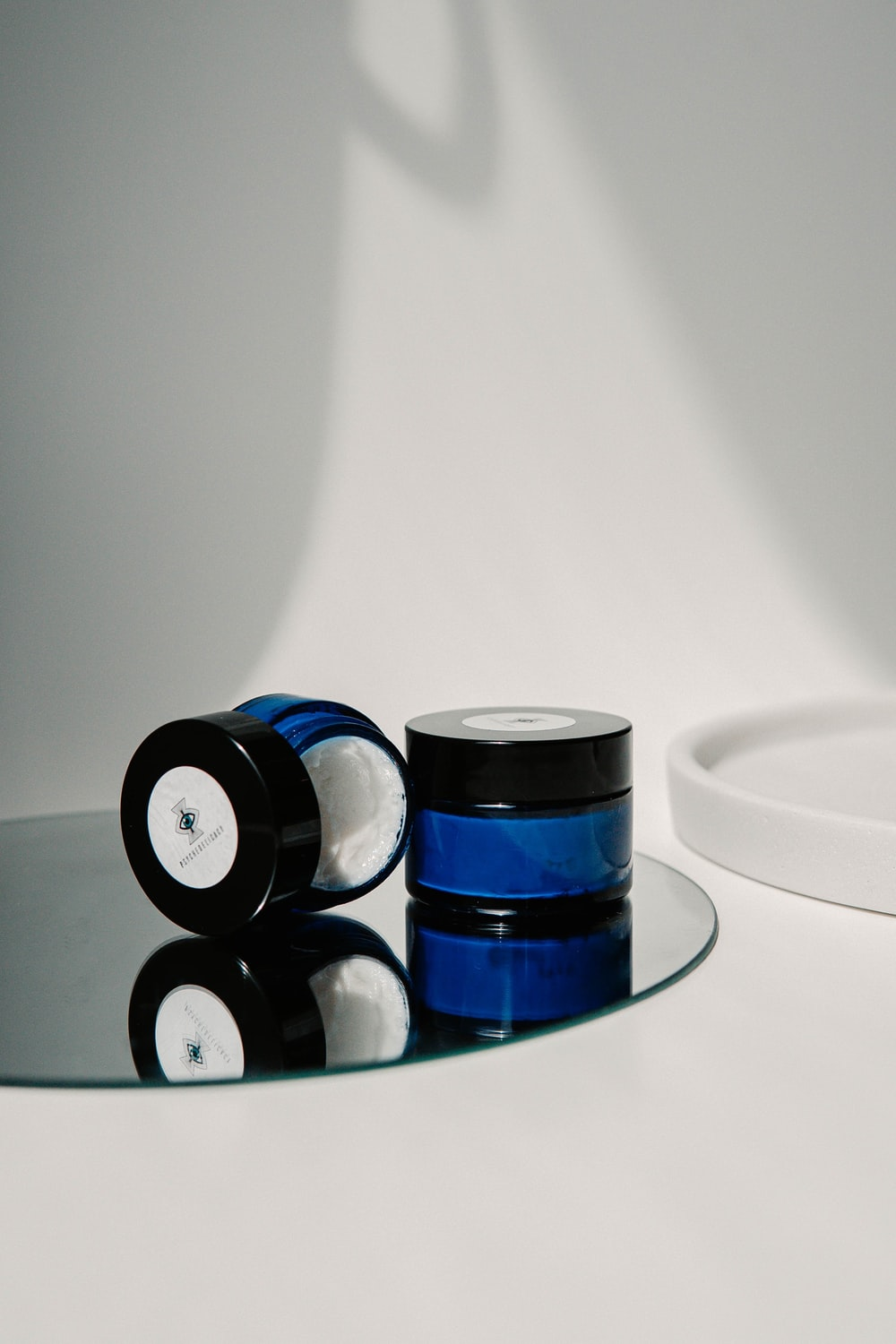 blue and black round container