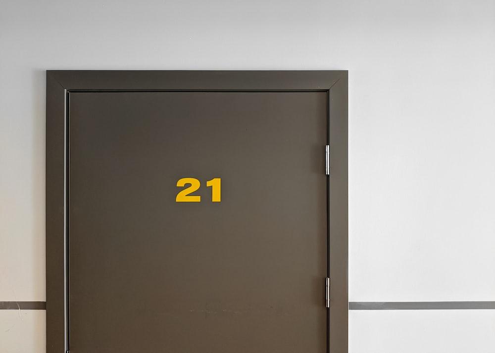 black and yellow x print door