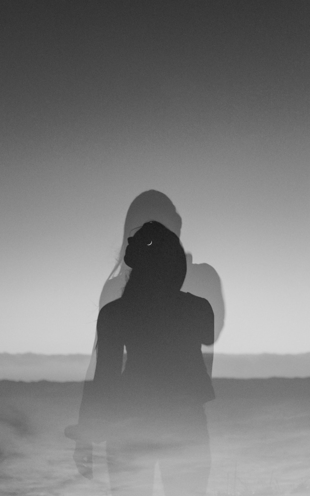 silhouette of person wearing hoodie