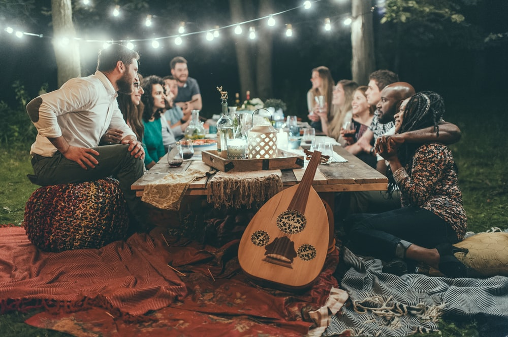 people sitting on chair in front of table with candles and candles