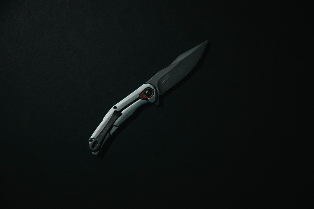 silver and black folding knife