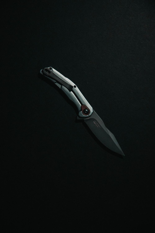 silver and black pocket knife