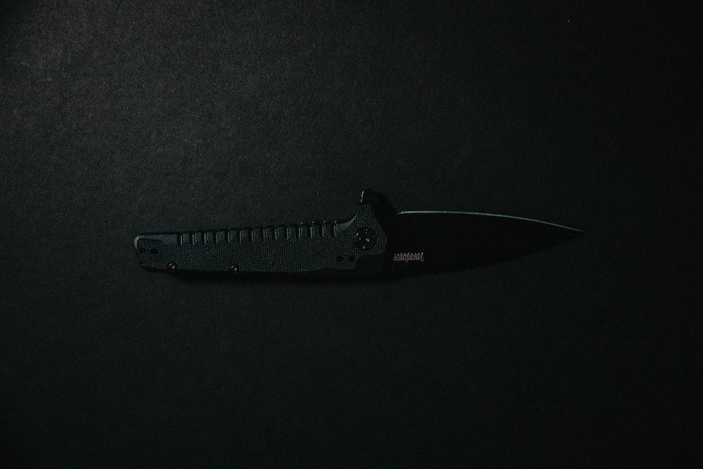 black knife on black textile