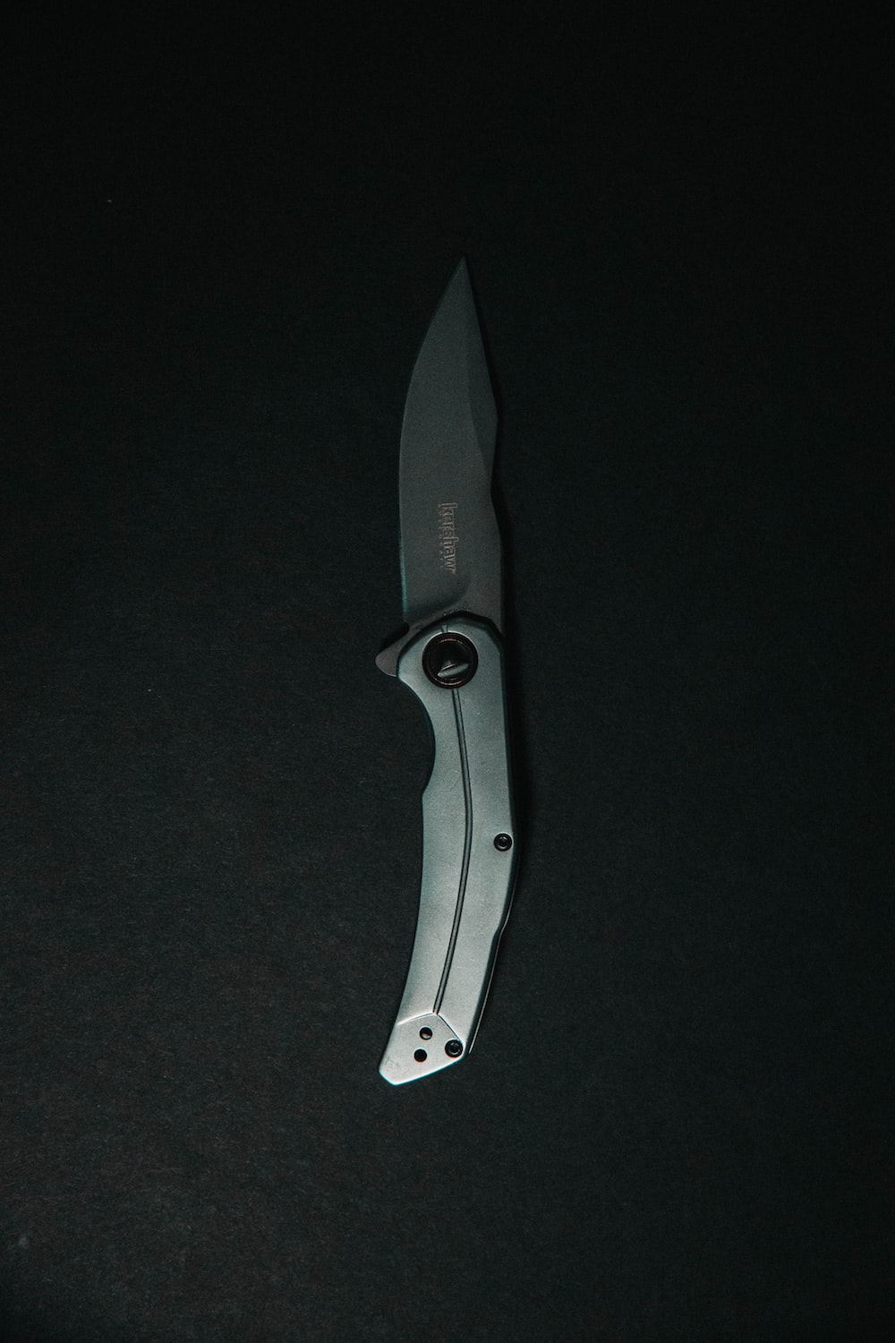 black and silver folding knife