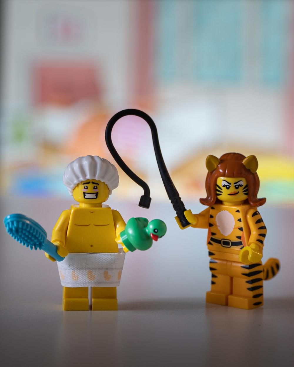 lego minifig holding black hose