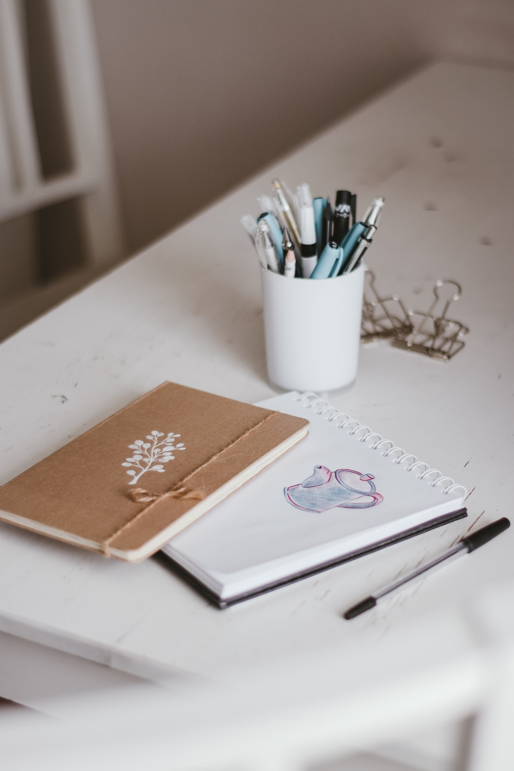 white and orange floral book on white table