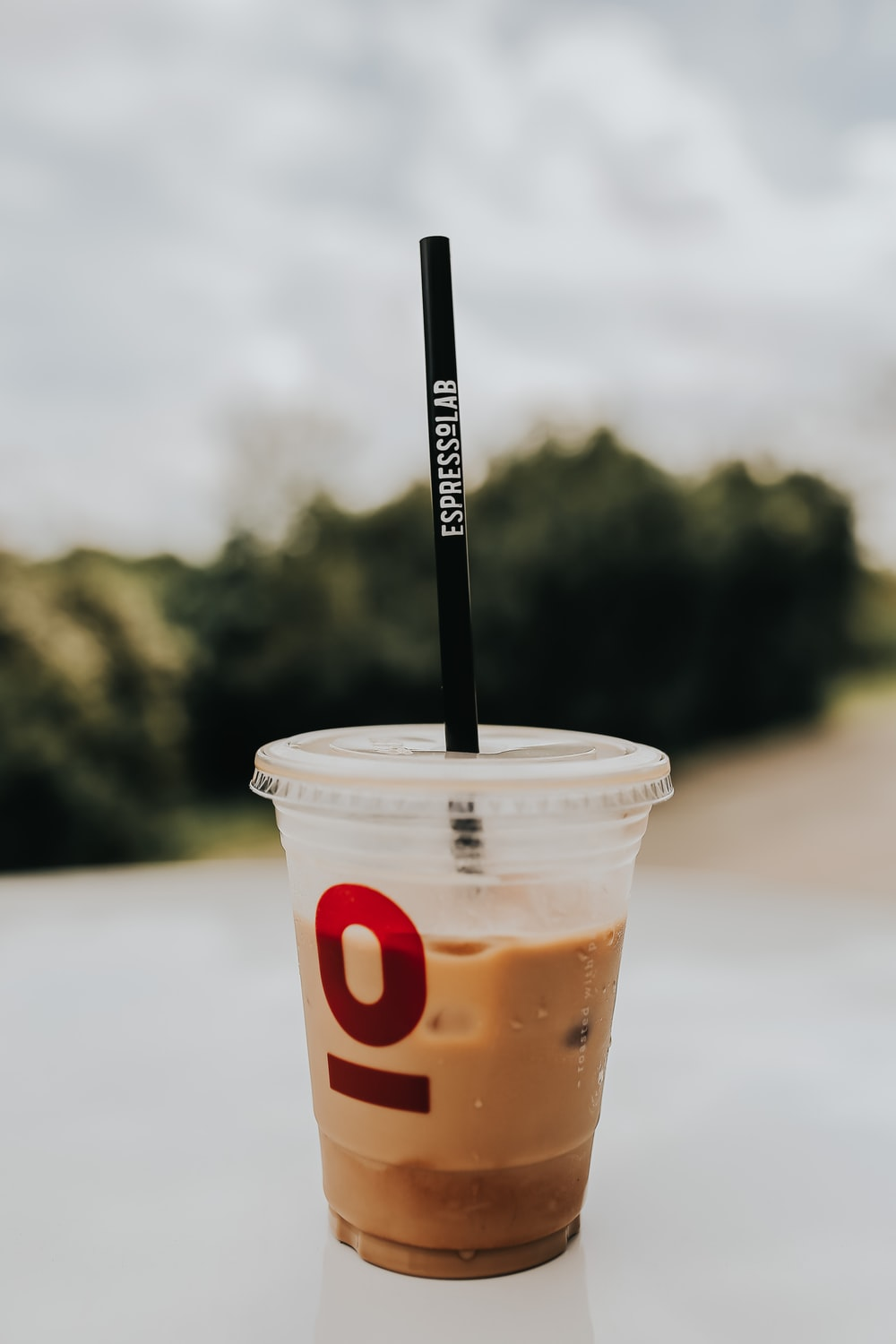 dunkin donuts disposable cup with black straw
