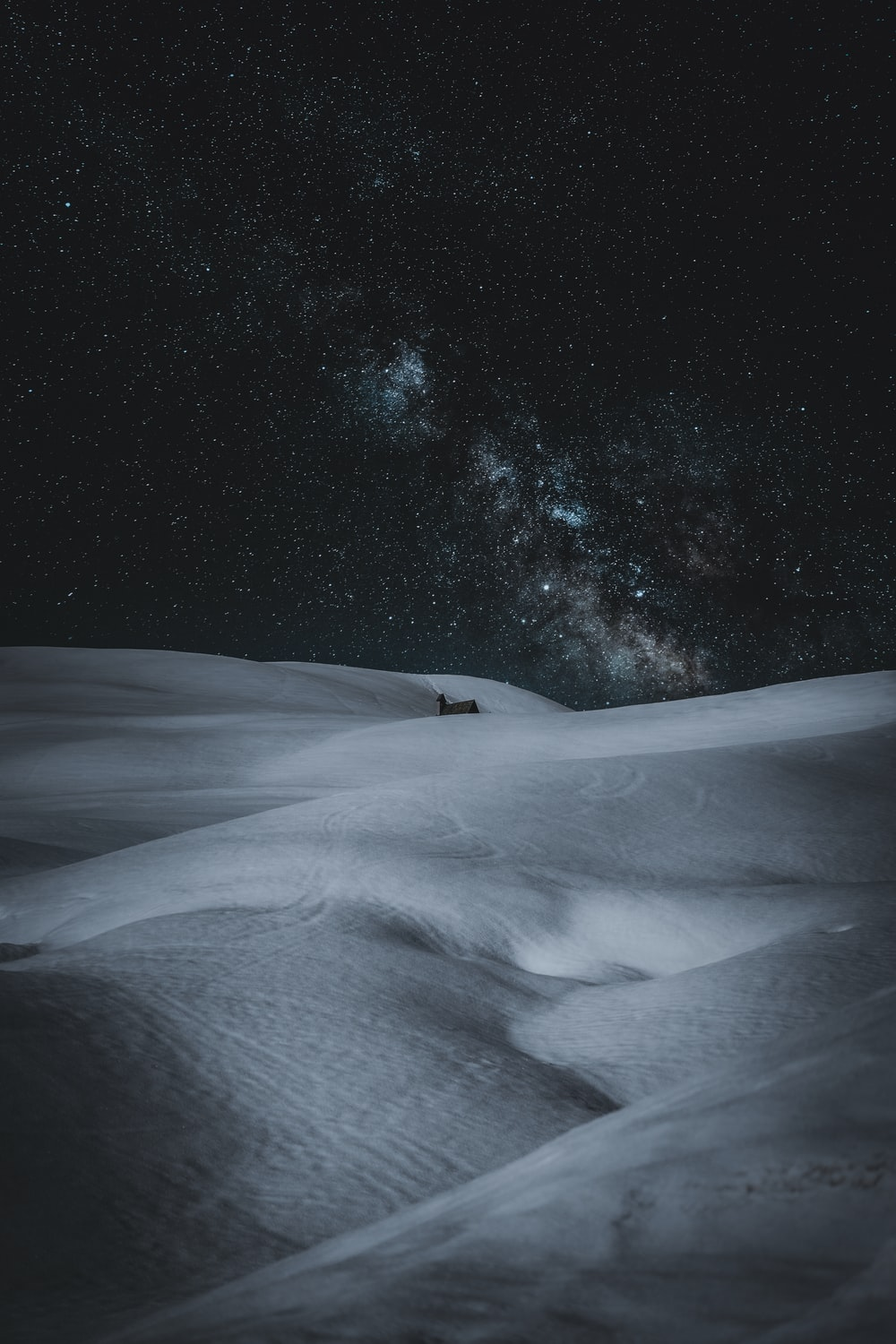 snow covered field during night time