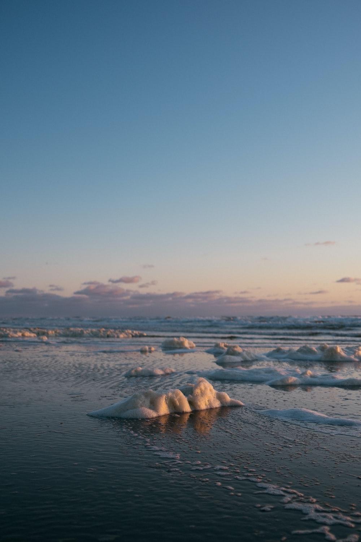 ice blocks on beach shore during daytime