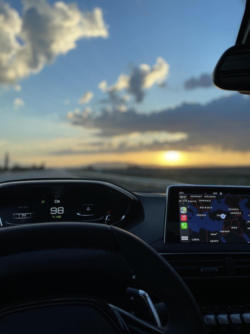 black car dashboard with digital device