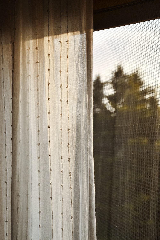 white window curtain during daytime