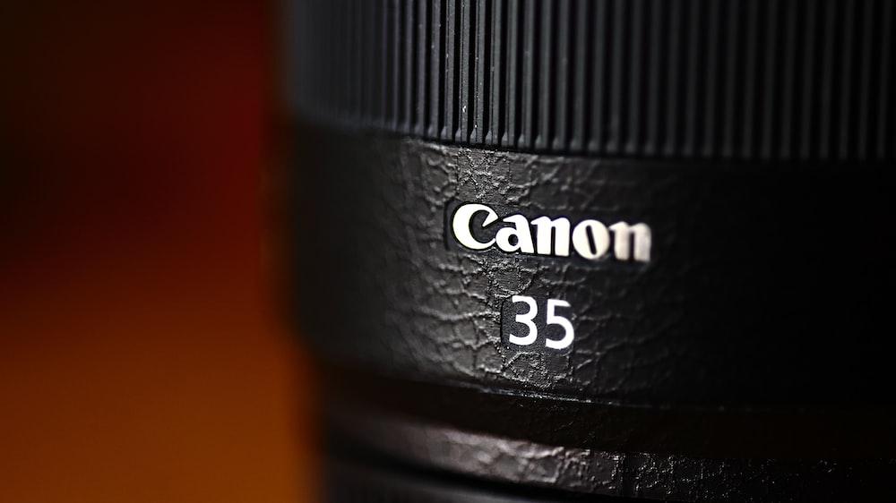 black camera lens on orange surface