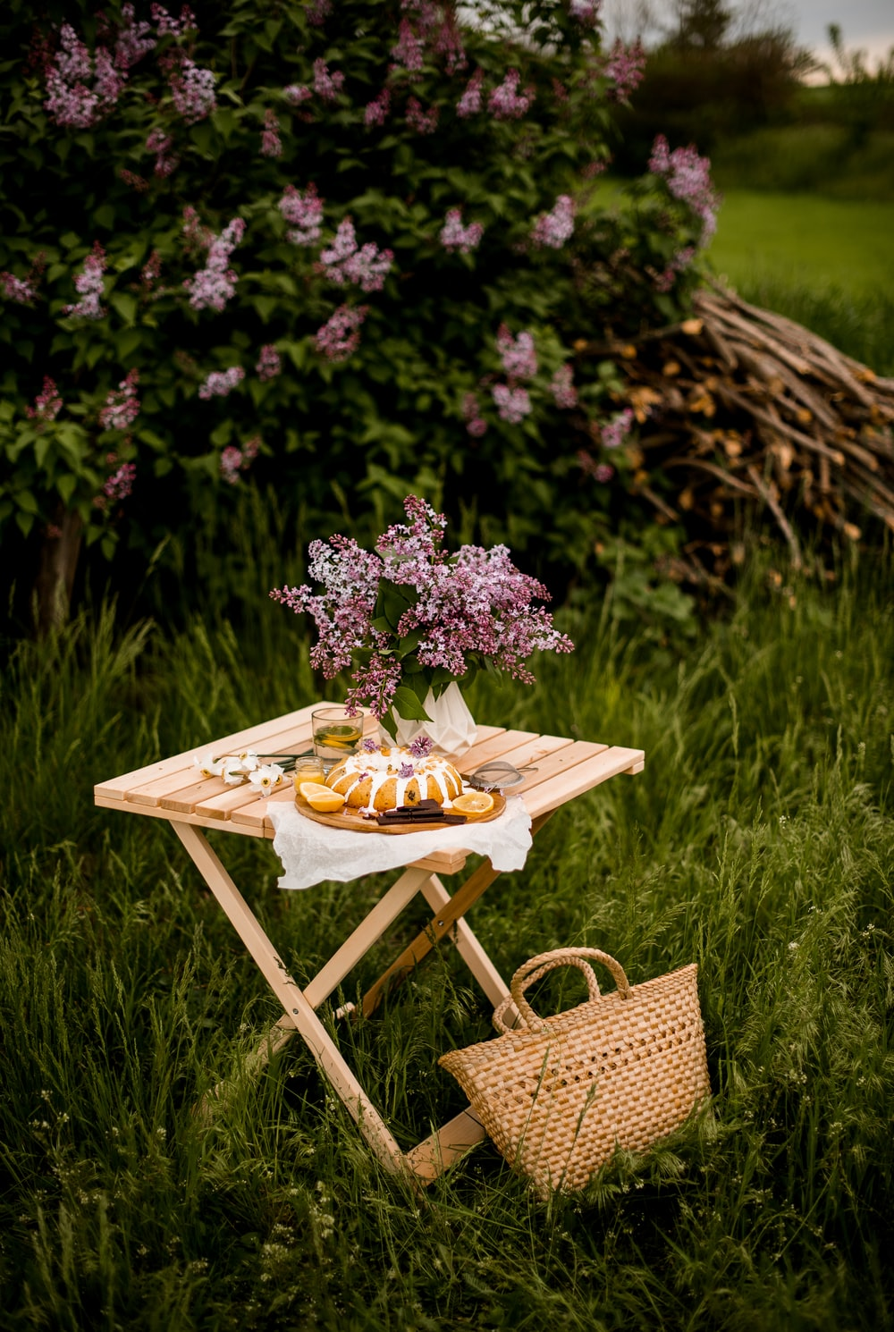 brown wooden table with flowers on top