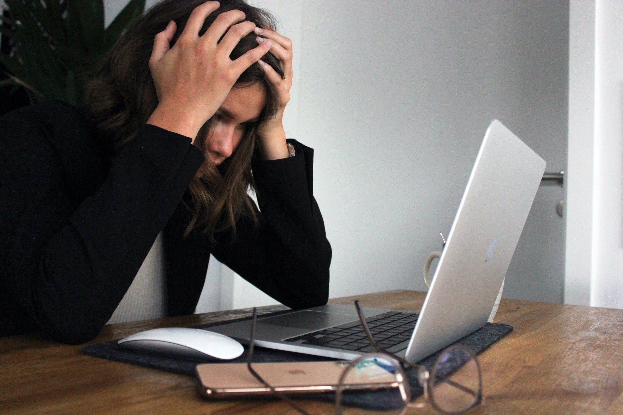a business woman who is stressed and frustrated