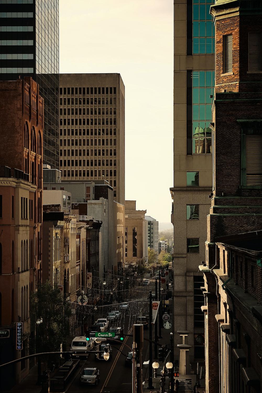 people walking on street between high rise buildings during daytime