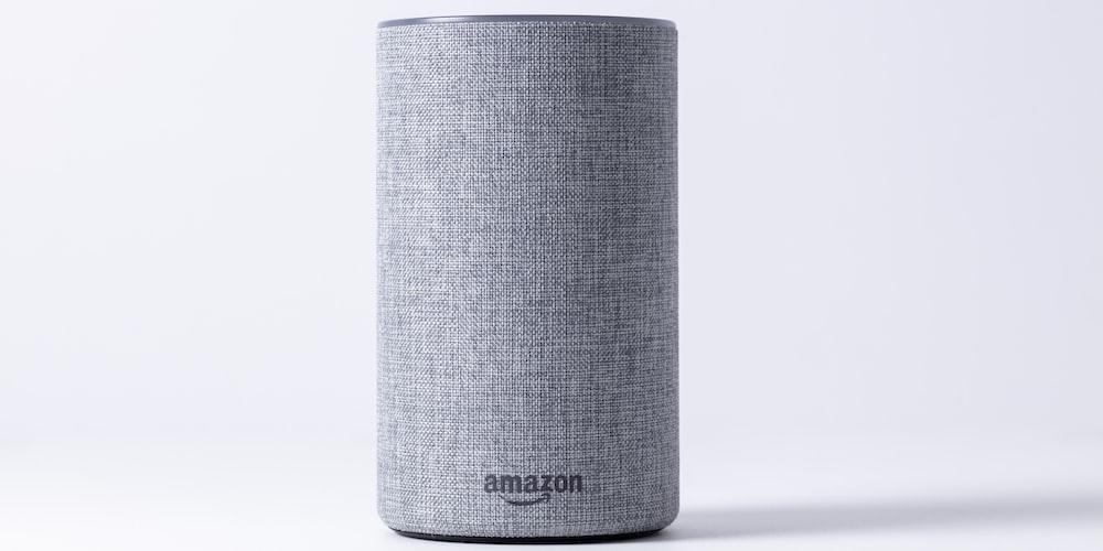 gray jbl portable speaker on white table