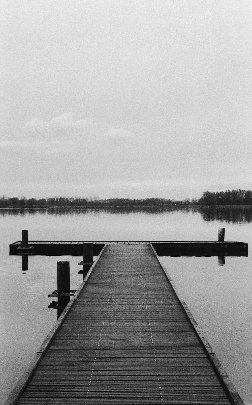 wooden dock on lake during daytime