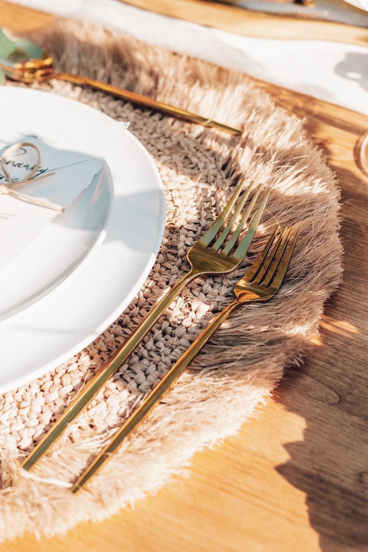 stainless steel fork on white ceramic plate