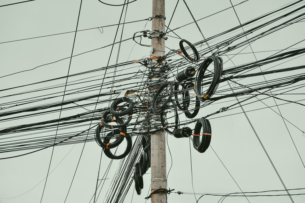 black and gray electric wires on electric post