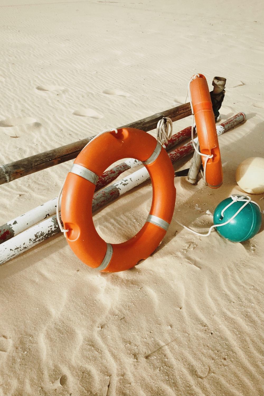 orange inflatable ring on sand
