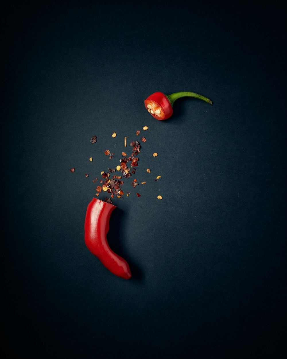 red chili pepper with green leaves