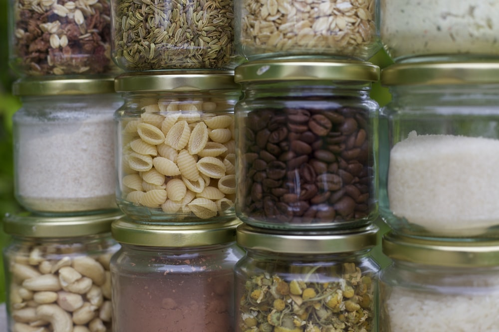 assorted spices in clear glass jars