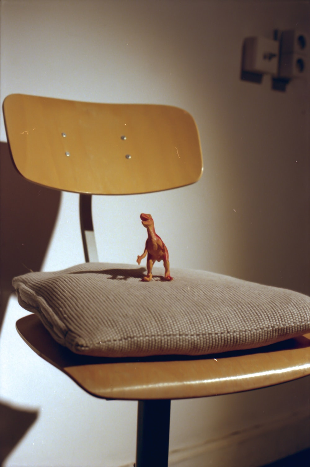 brown dog figurine on brown wooden chair