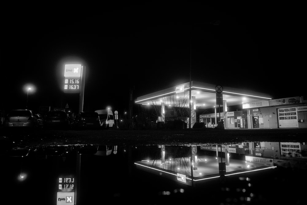 grayscale photo of city buildings during night time