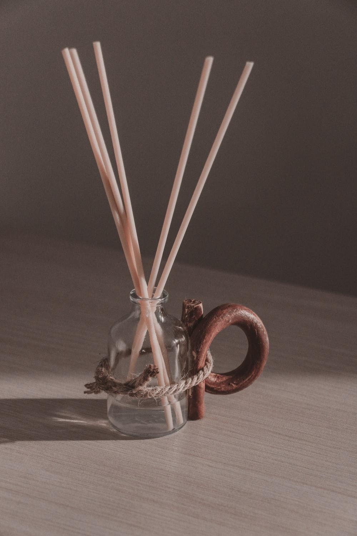 brown sticks in clear glass jar