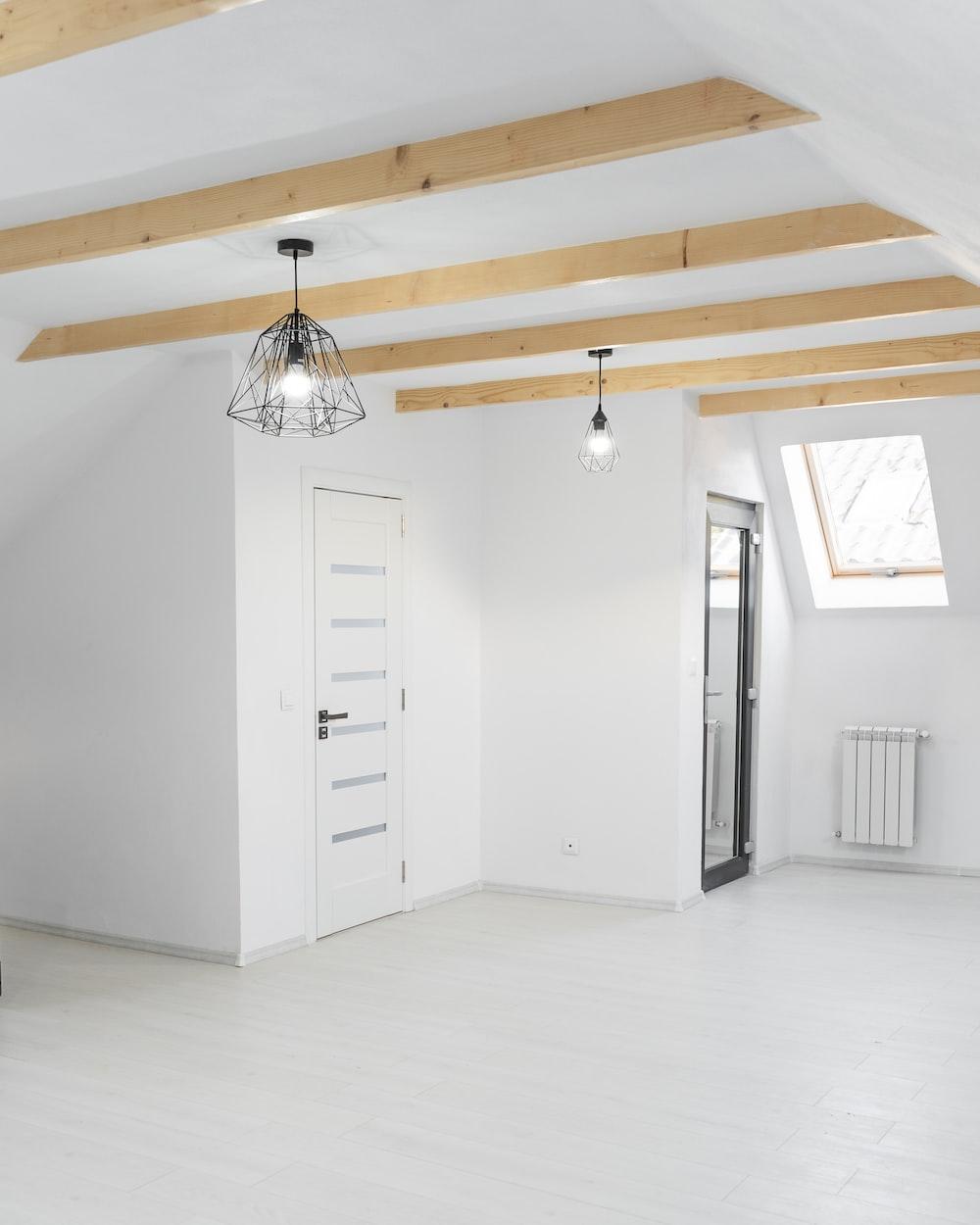white wooden cabinet near white wooden door