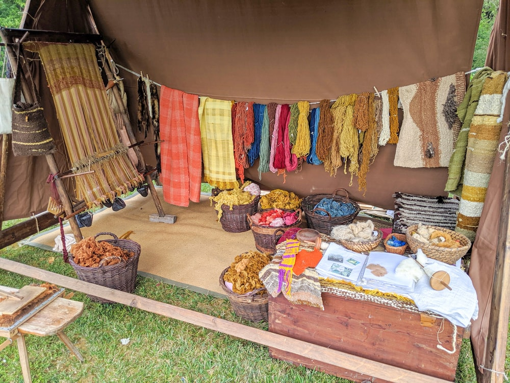 assorted color textiles on brown wooden table