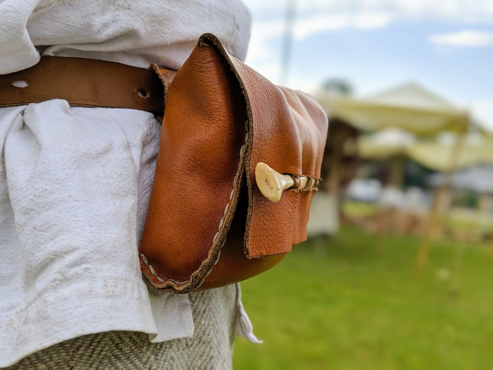 woman in brown leather shoulder bag