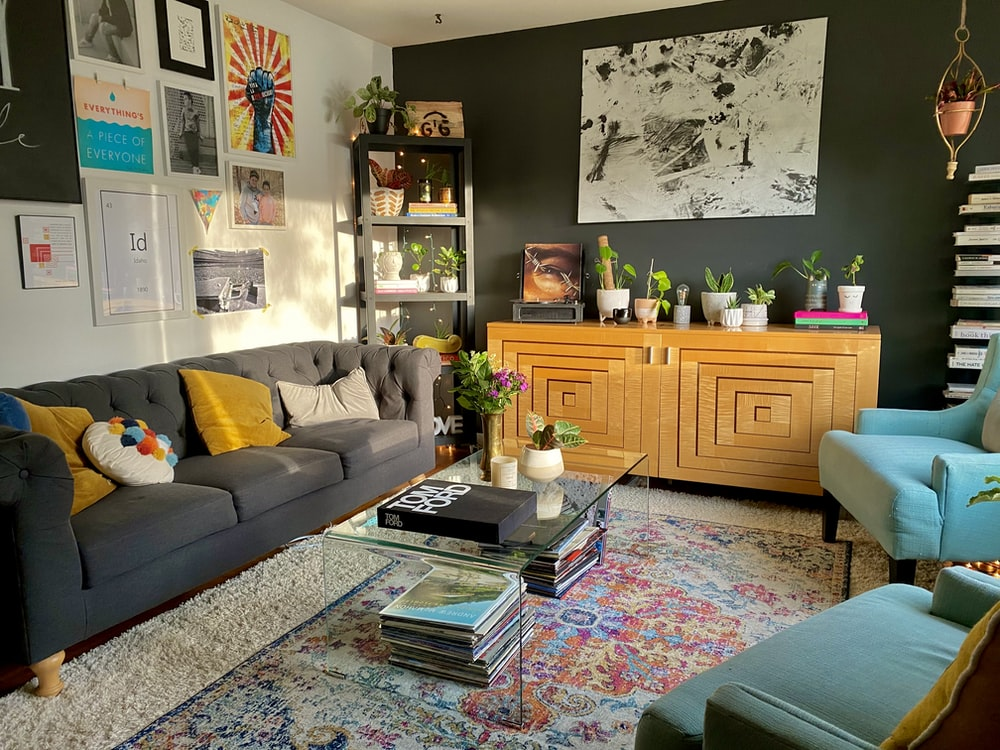 brown wooden cabinet near gray couch