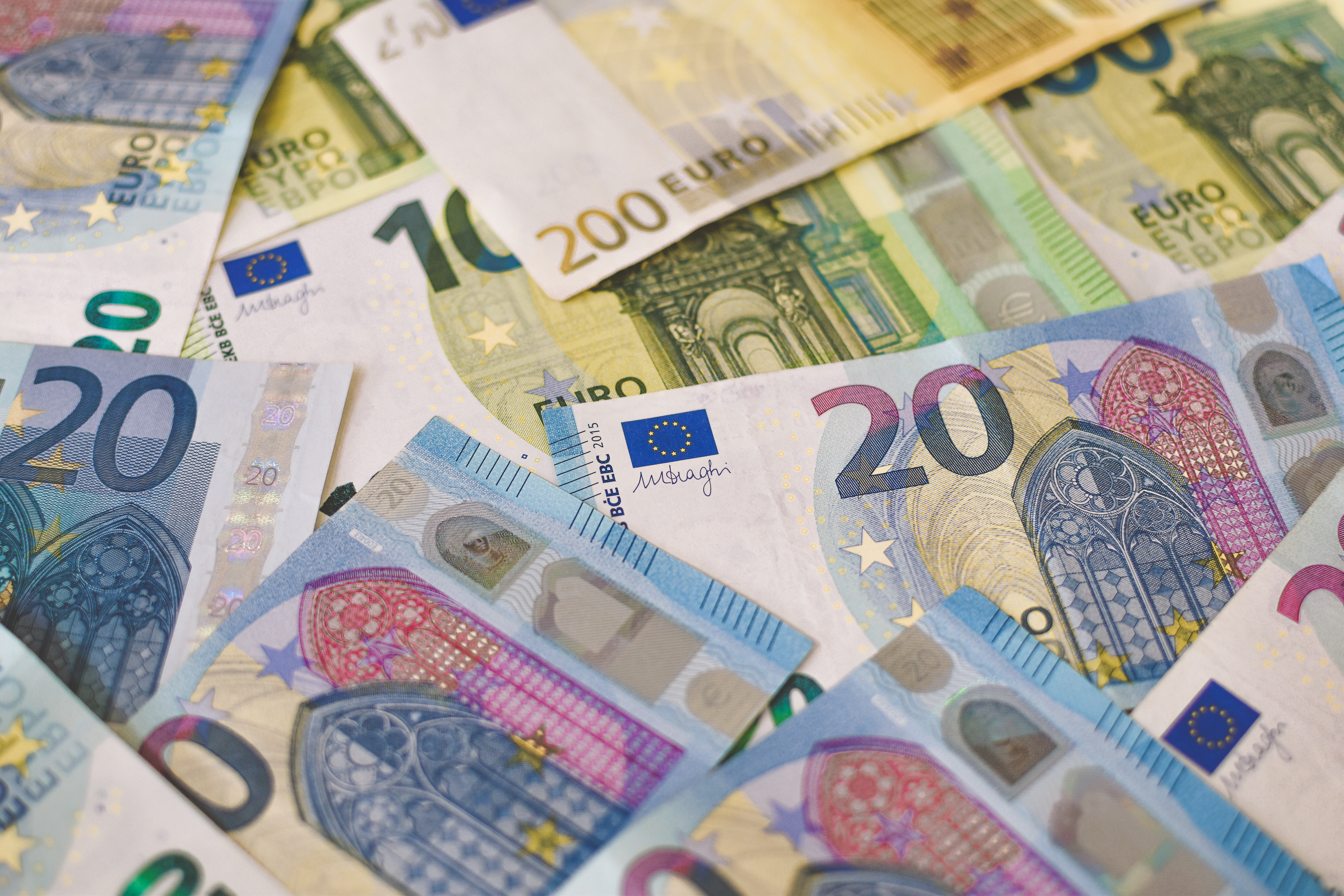 A pile of Euro (EUR) banknotes that include 20, 100, and 200 notes. (Part II)