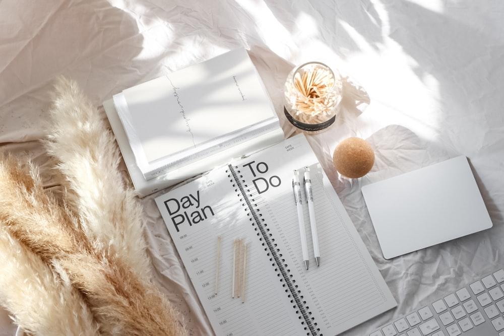 white pen on white notebook