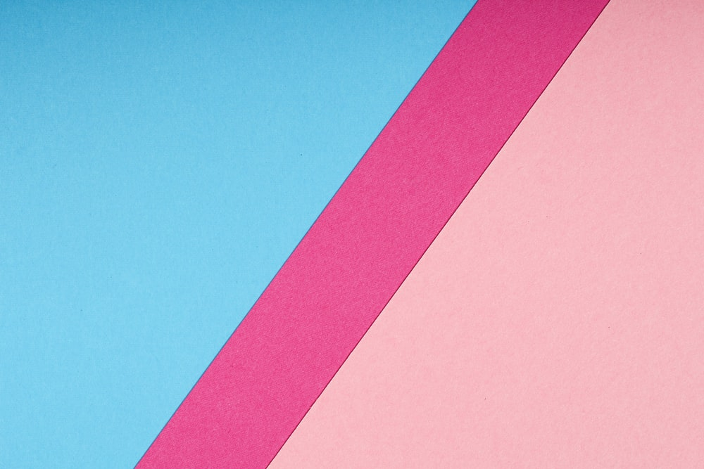 pink paper on blue background