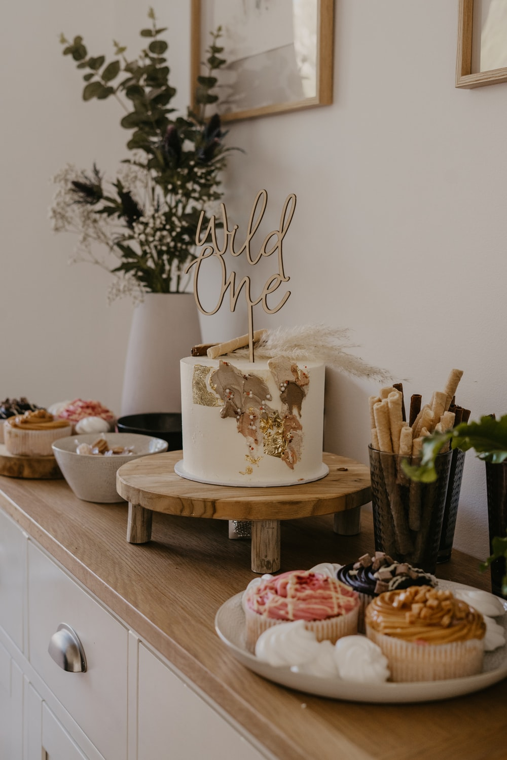 white and brown cake on brown wooden table
