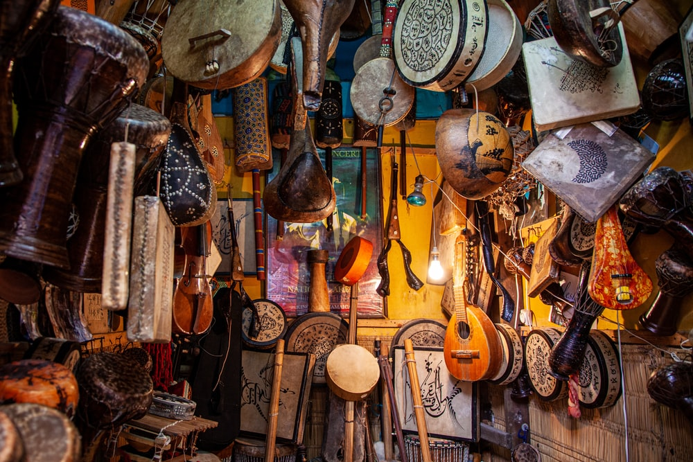 brown wooden guitar hanging on wall