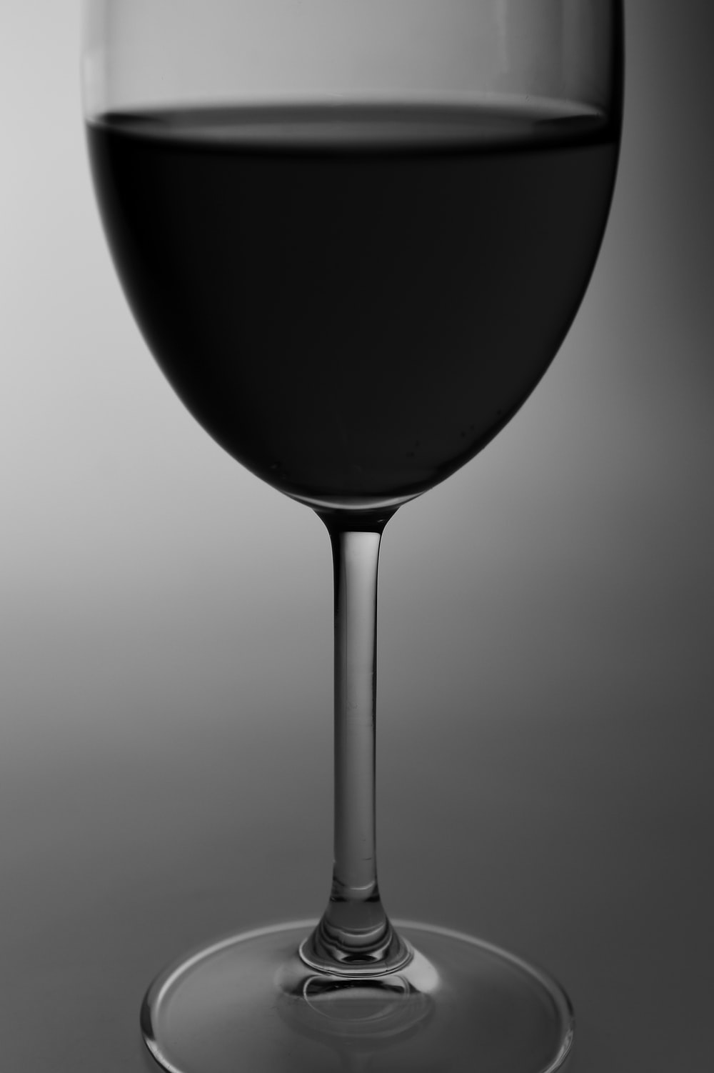 black wine glass on white surface