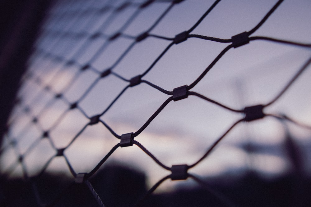 black metal fence with light