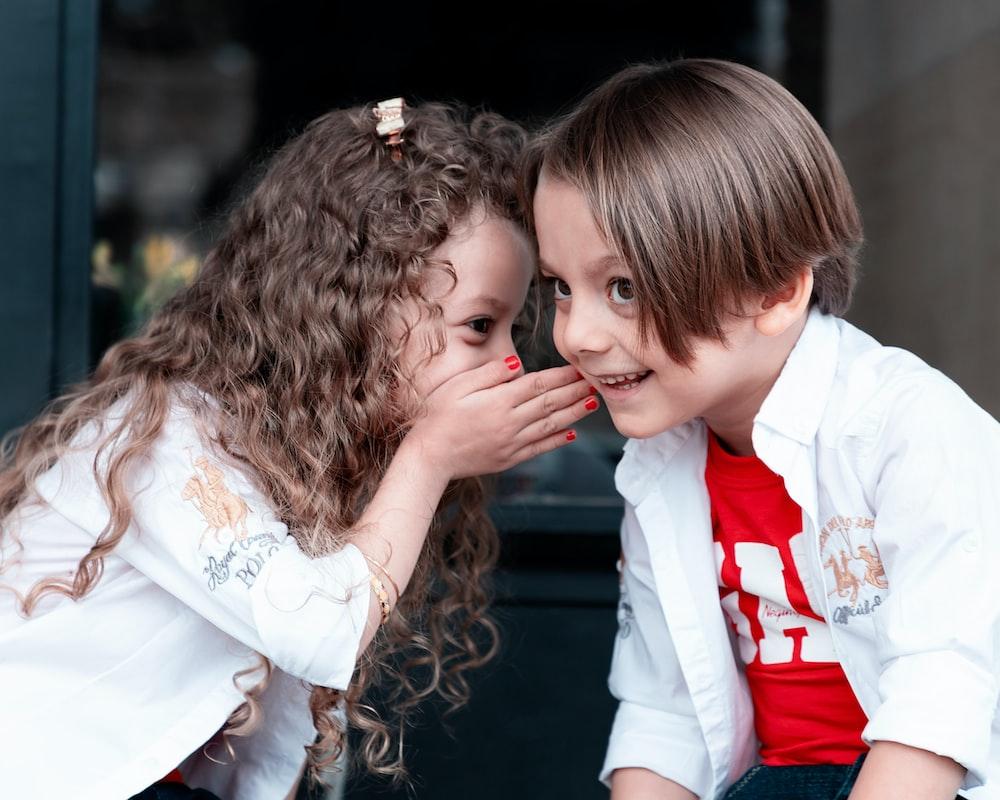 woman in white long sleeve shirt kissing girl in white long sleeve shirt