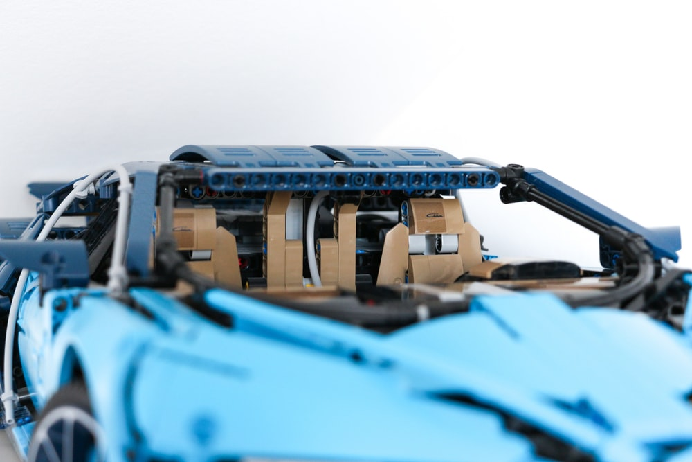 blue car with brown truck