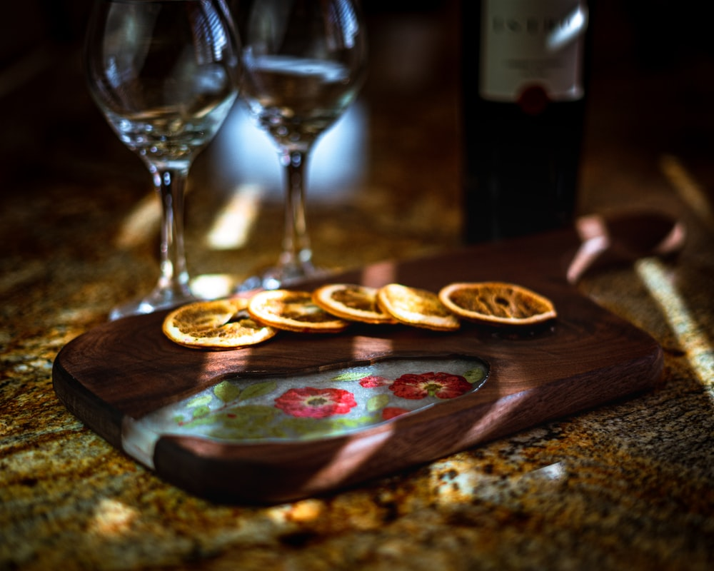 brown wooden board with brown wooden plate and wine glass