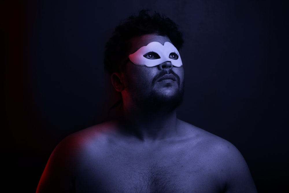 topless man with white mask