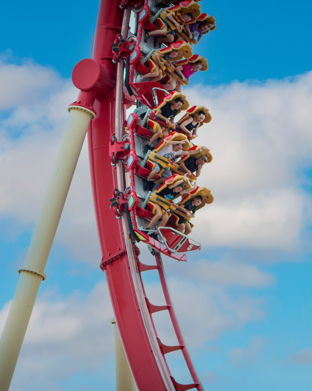 people riding roller coaster during daytime