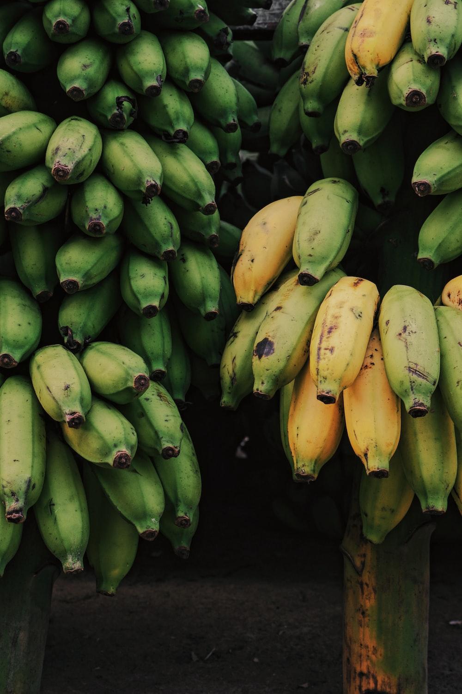 green banana fruit on black surface